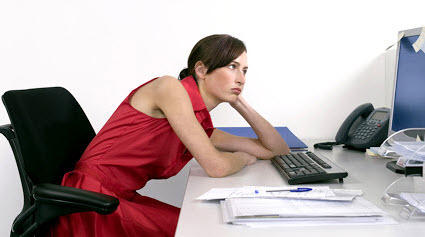 Slouching Women Sitting At Desk